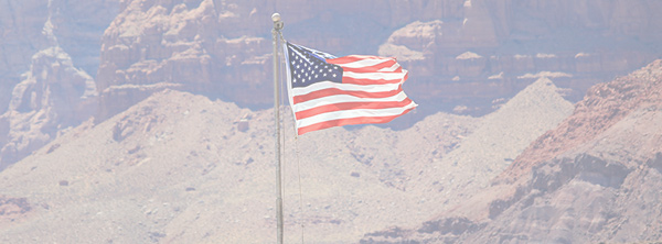 American Flag against Mountains